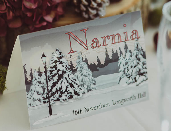 Snow covered Narnia inspired wedding invitations and stationery