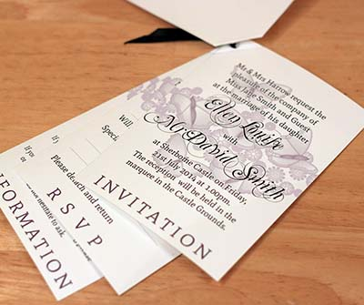 Corner fastening booklet wedding invitations include an rsvp and a map section